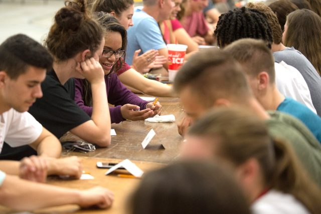 Students play Bunco, a dice game, at a CAB event during Homecoming weekend.