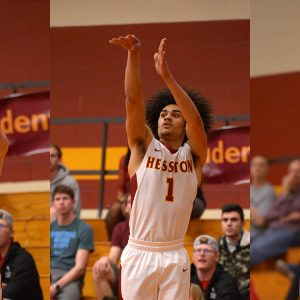 Hesston College men's basketball action photo - Cal Hartley, David Ladwig, Aubrey Johnson