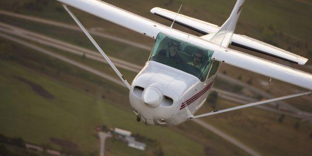 Hesston College plane in flight