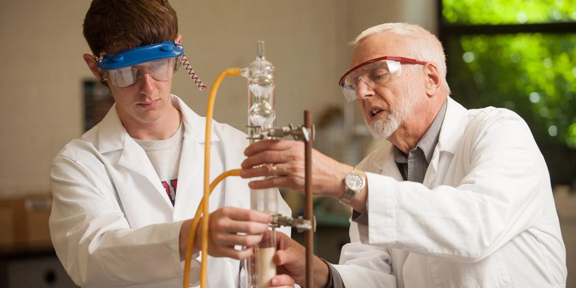 Jim Yoder works with organic chemistry student Jared Hague in spring 2016