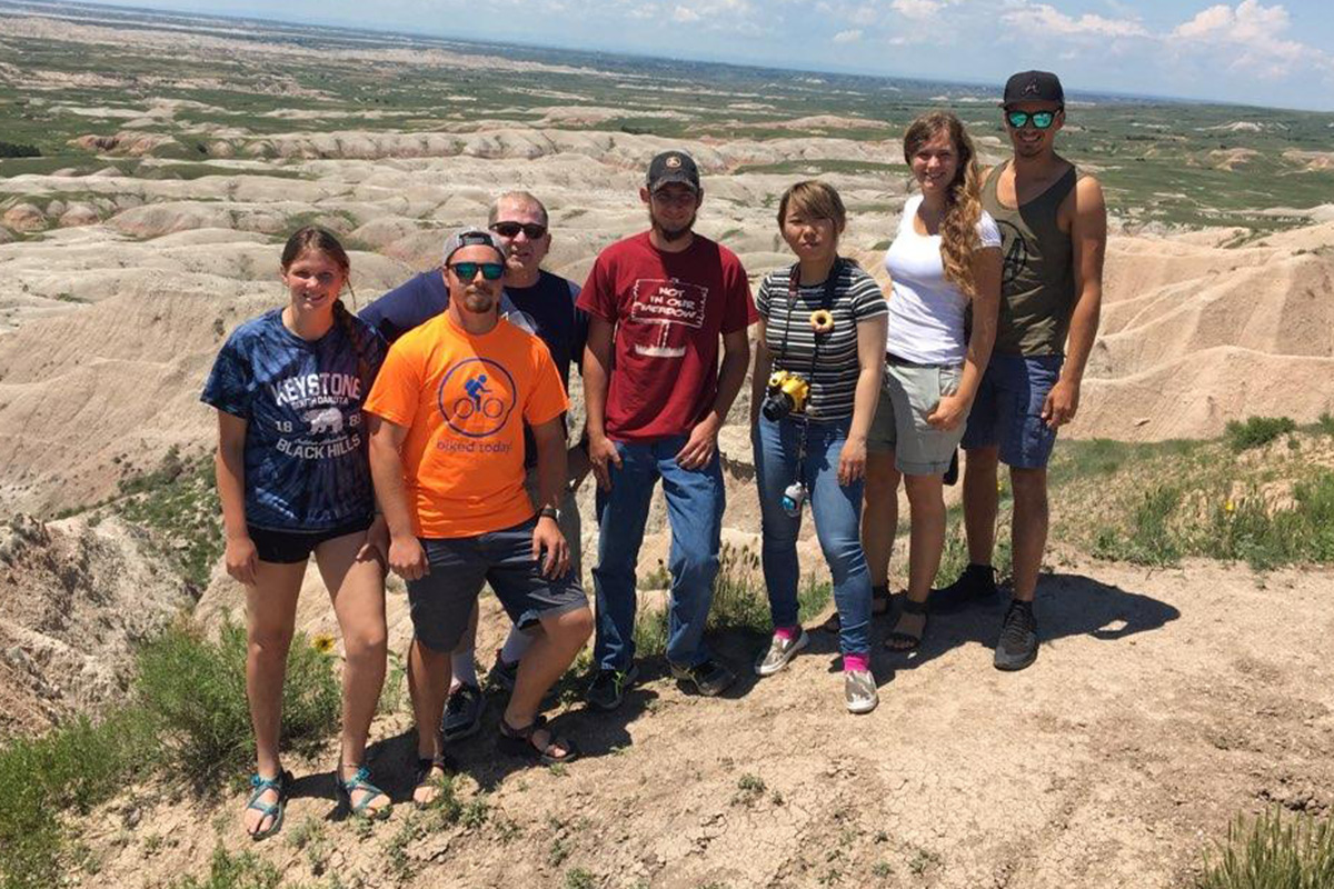 Disaster Management students serving in Pine Ridge, S.D., take time out of their work to visit the Badlands.