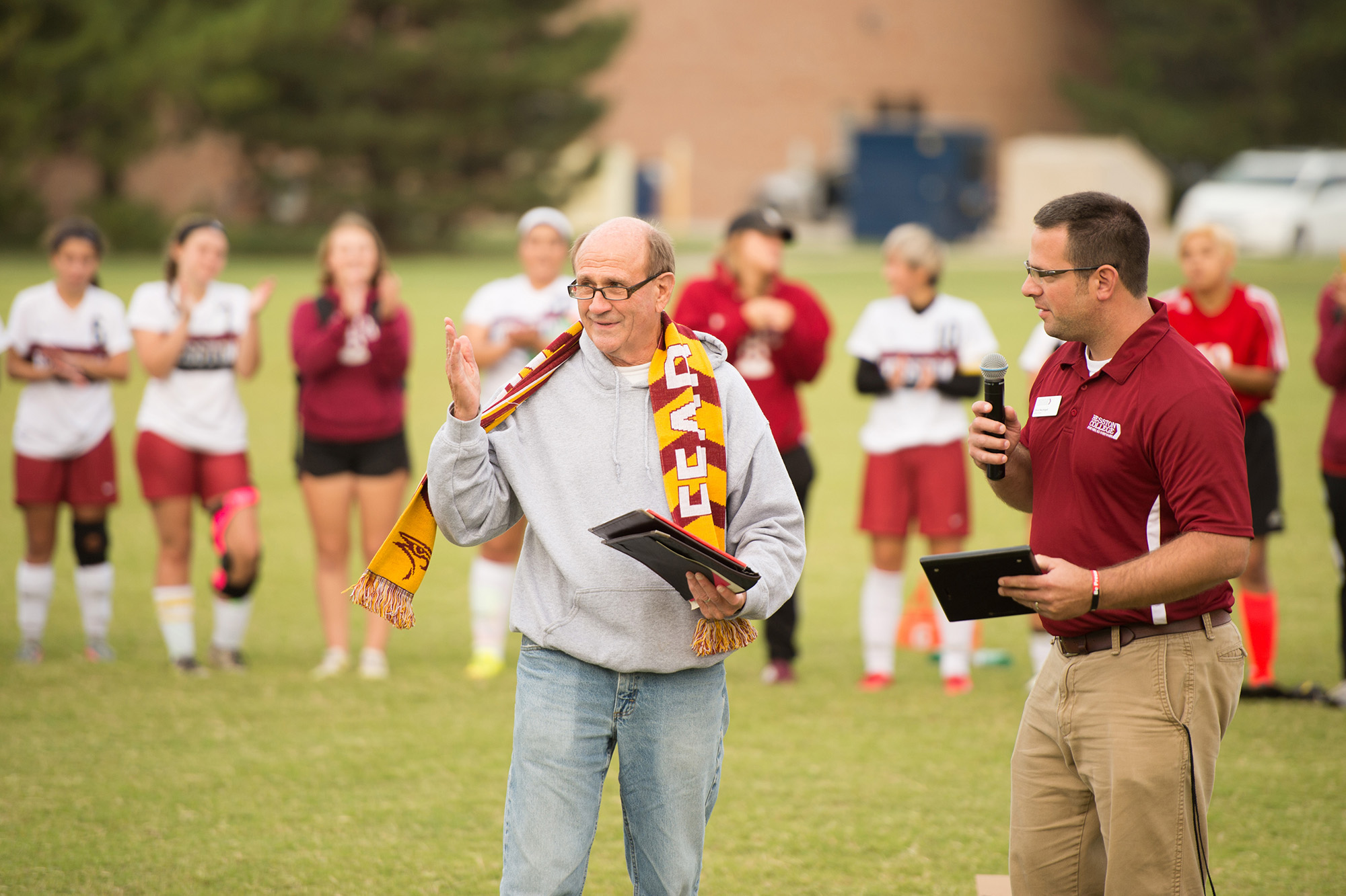 Gerry Sieber '64, faculty emeritus, addresses the crowd at the renaming of the soccer field.