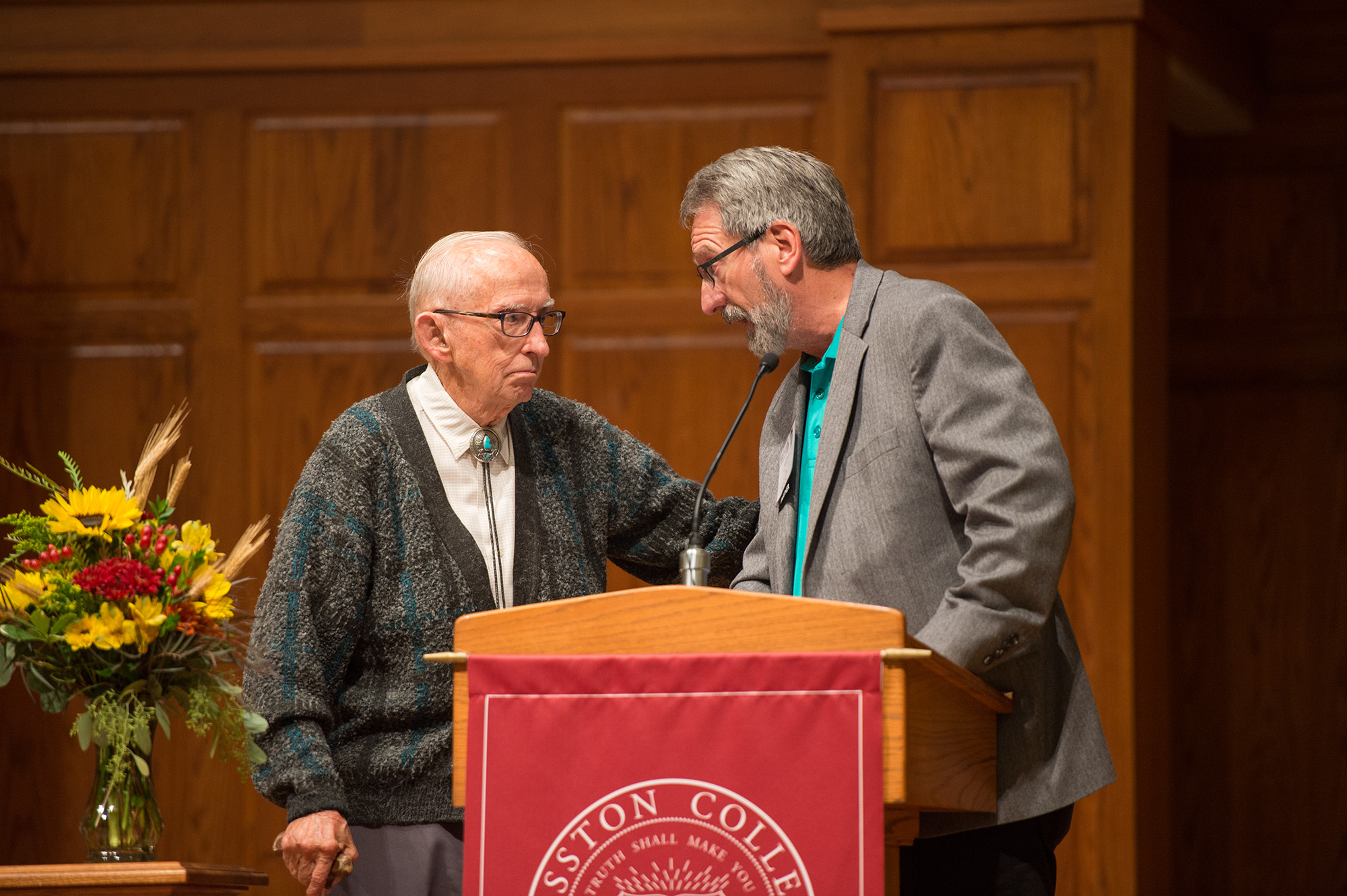 Evan Oswald '48, former faculty and John Sharp '73, former faculty speak at the 60 years of Lark Athletics event.