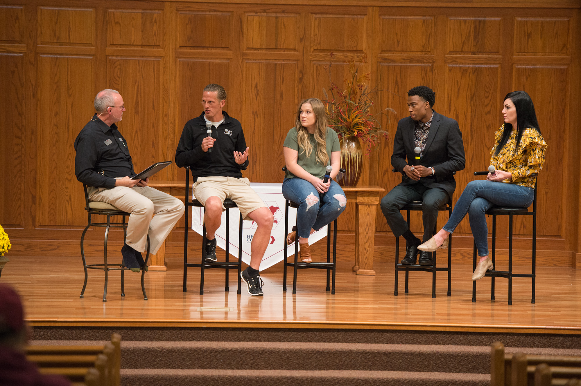 John Murray '81 moderates a panel of Lark alumni athletes including Andrew Sharp '99, Kymee Noll '15, Malcolm Mann '15 and Ashley (Kaufman) '07 Moore at a Go Everywhere seminar.