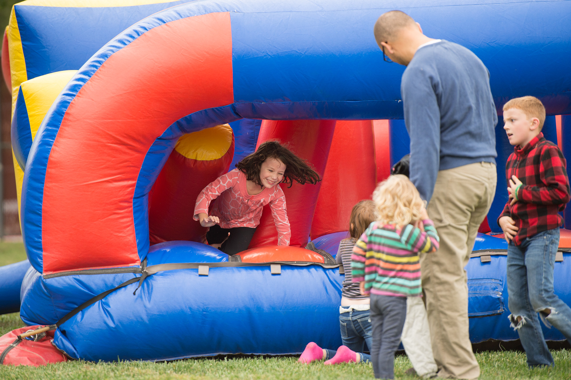The college hosted a kid fest with inflatables and face painting for alumni and the Hesston Community.