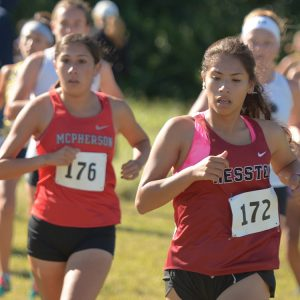 Hesston College women's cross country action photo - Sam Trejo