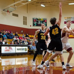 Hesston College men's basketball action photo