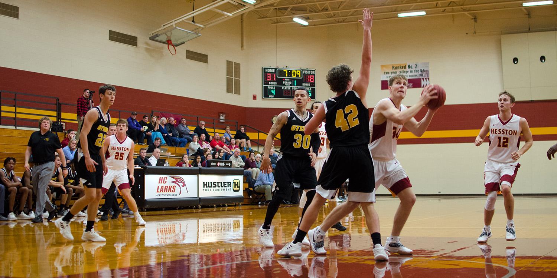 Hesston College men's basketball action photo