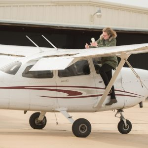 Hesston College Aviation student, Gracie Hochstetler (Leesburg, Ind.), goes through pre-flight checks on one of the college's planes. Hesston College Aviation recently entered into a partnership with passenger airline company SkyWest Airlines that will give Hesston graduates connections and a more streamlined and efficient pathway to transition into a flying career.
