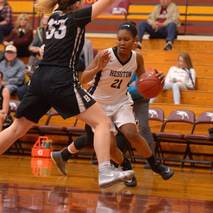Hesston College women's basketball action photo - Millaya Bray