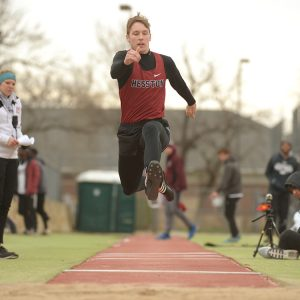Seth Rudeen competes in triple jump at the Friends meet last spring.