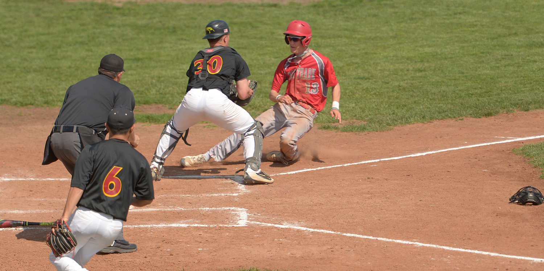 Hesston College baseball action photo