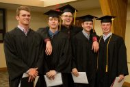 Graduates of the men's basketball team celebrate together. From left: Grant Harding (Louisburg, Kan.), Kendall Pelton (Cheyenne Wells, Colo.), C.R. Curless (Haysville, Kan.), Braden Handcock (Brighton, Colo.) and Cal Hartley (Benton, Kan.).