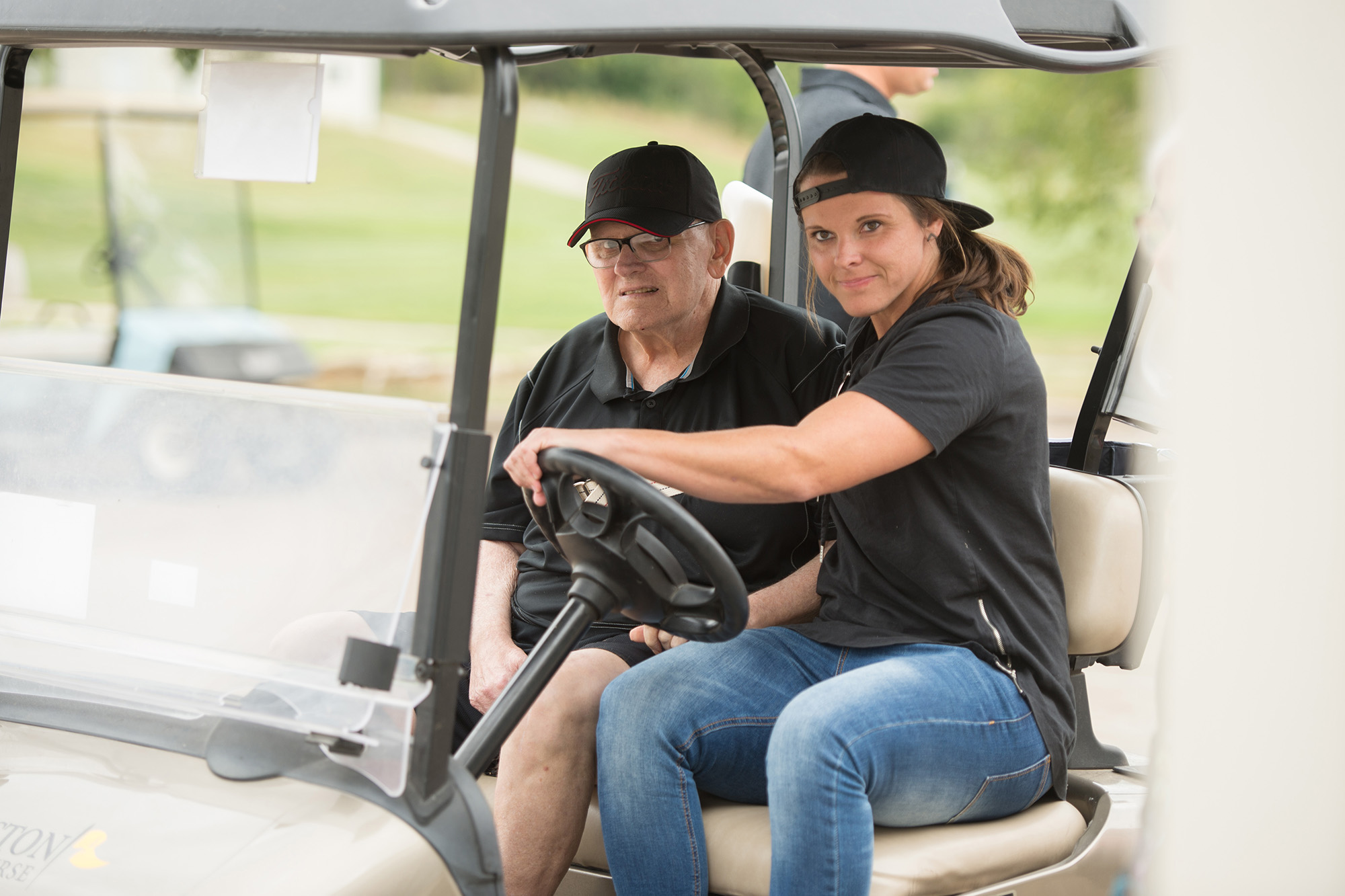 Katie Sowers '06 chauffeurs her dad, Floyd Sowers '71, at the Homecoming Golf Benefit in Floyd's honor.