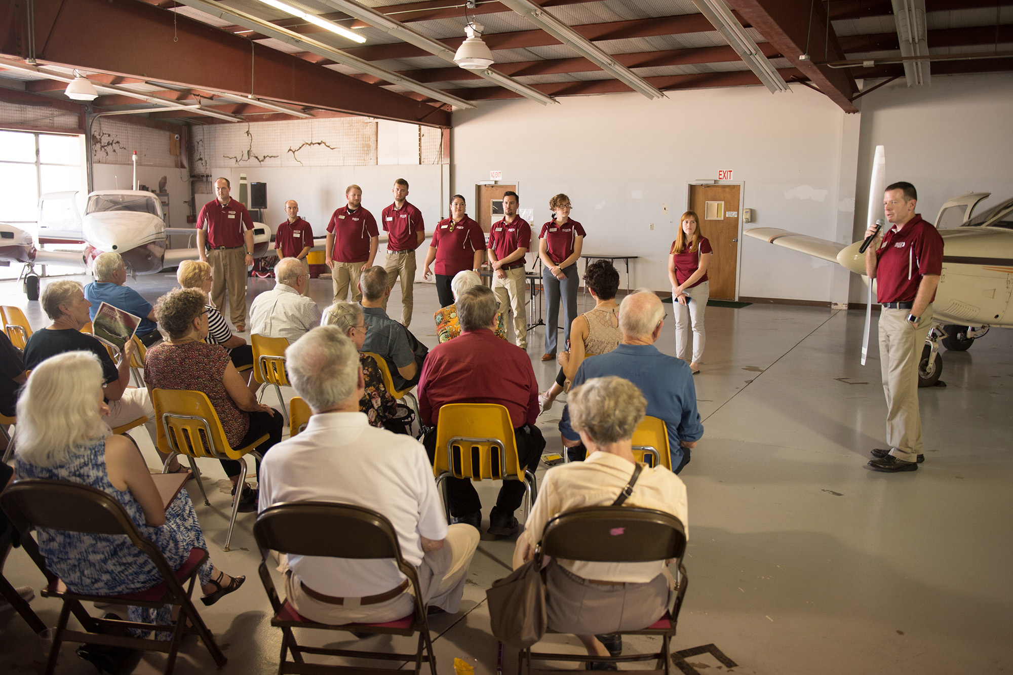 Aviation director Mike Baker introduces the aviation faculty and staff at an open house Friday afternoon.
