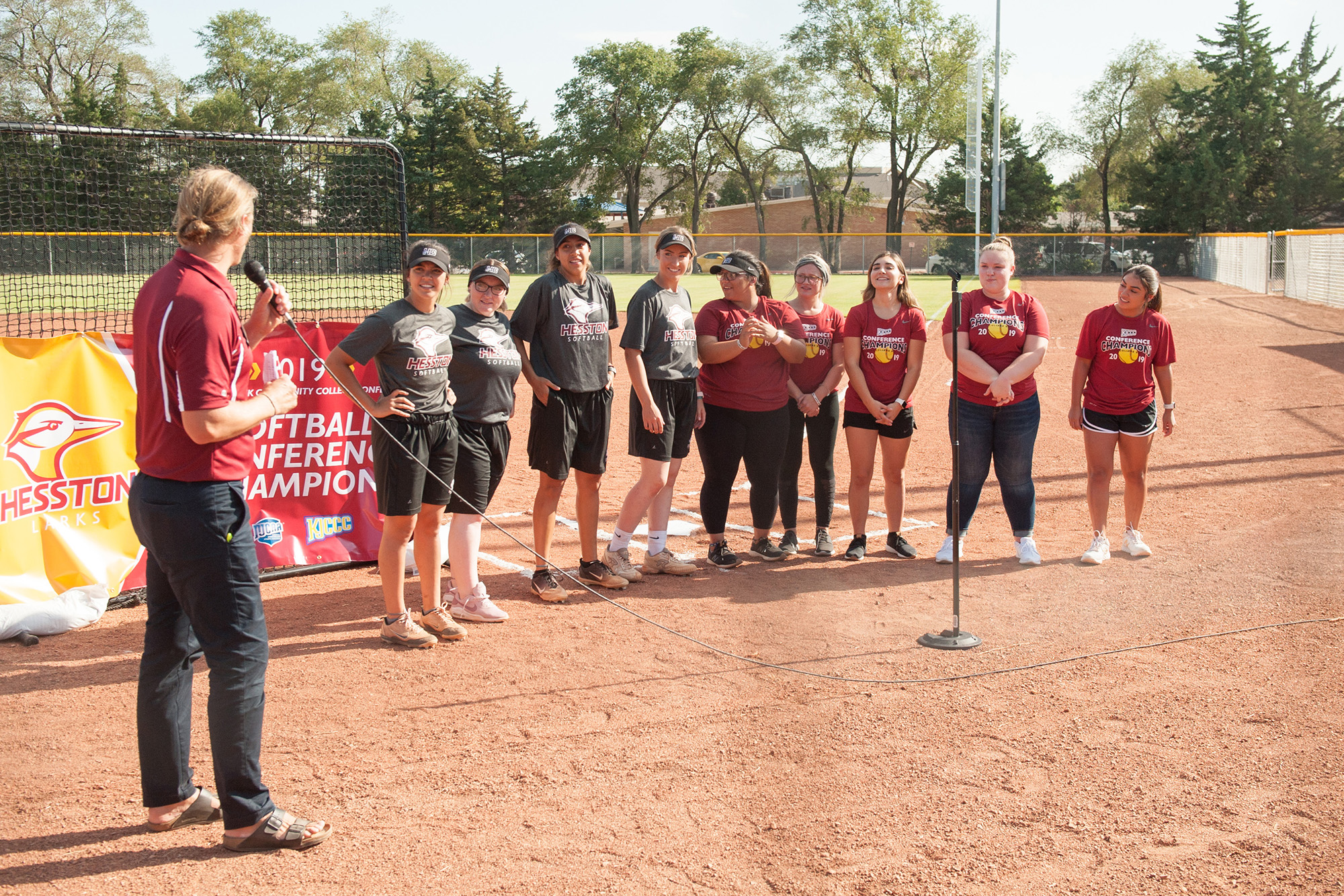 Former Coach Andrew Sharp introduces members of the 2019 Kansas Jayhawk Conference champion Hesston College Larks softball team.