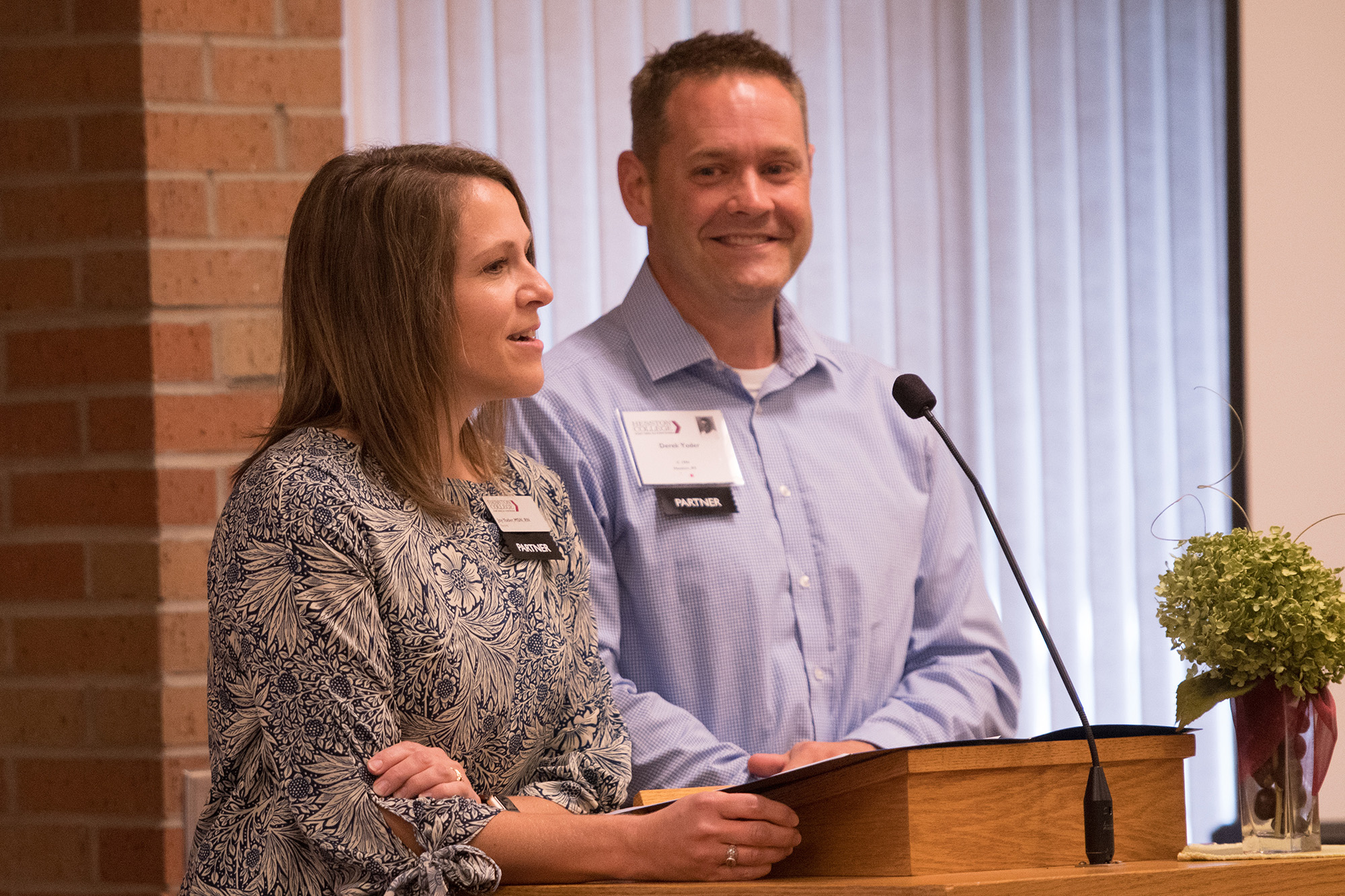 Nursing prof Joy (Smith) '96 and former staff Derek '96 Yoder speak at the annual Partner Luncheon.