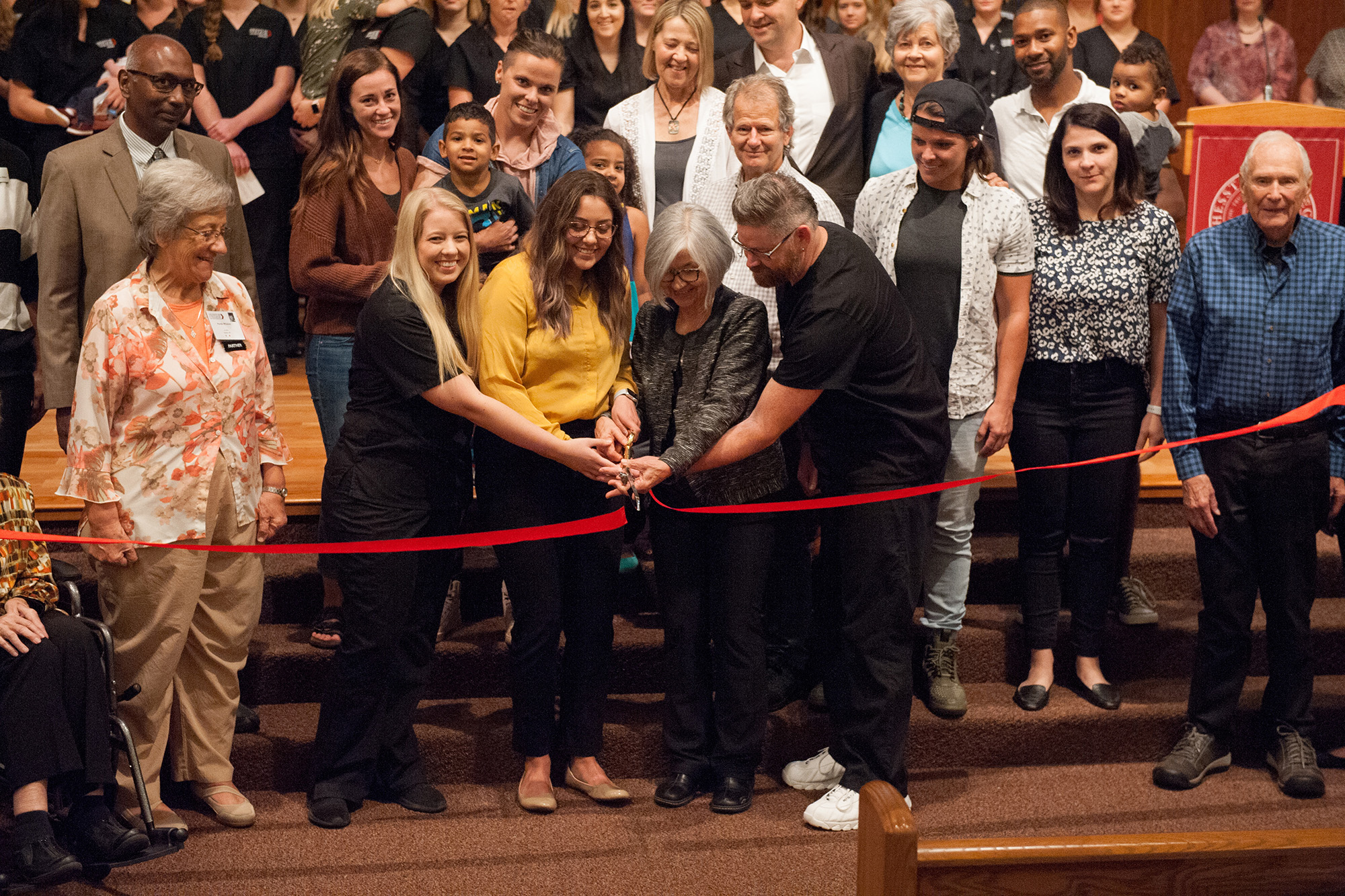 Bonnie Sowers, former director of nursing education, and several current nursing students cut the ribbon at the Bonnie Sowers Nursing Center dedication.