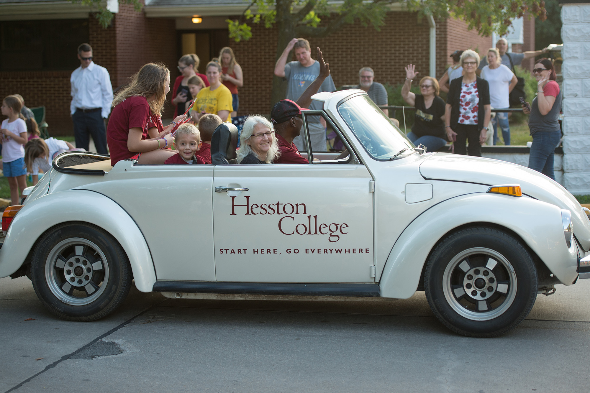 Hesston College President Joe and Wanda Manickam drive the HC bug in the Home Sweet Hesston parade.