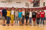 The 1996-97 Lark women's basketball team was honored for its trip to nationals during the Yost Center renovation dedication. Pictured from left are Joel Kauffman '80, head coach, Janel (Jantz) '97 Stucky, Lisa (Schmidt) '97 Graber, Janelle Yutzie '97 -Blubaugh, Becky Nitzsche '98, former staff, Green, Shanna (Roth) '97, former staff, Heinz, Carla (Hathaway) '97 Hochstetler, Tasha (Propps) '97 Warner, Joy (Smith) '96 Yoder, faculty, assistant coach, Sarah (Nitzsche) '96 Simms (played on 1995-96 team), and Sarah (Tabor) '97 Kirk.
