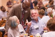 President Manickam talks with Judy (Dorsing) Ac59, '61 and Cecil Ac57, '59 Miller at the Partner Luncheon.