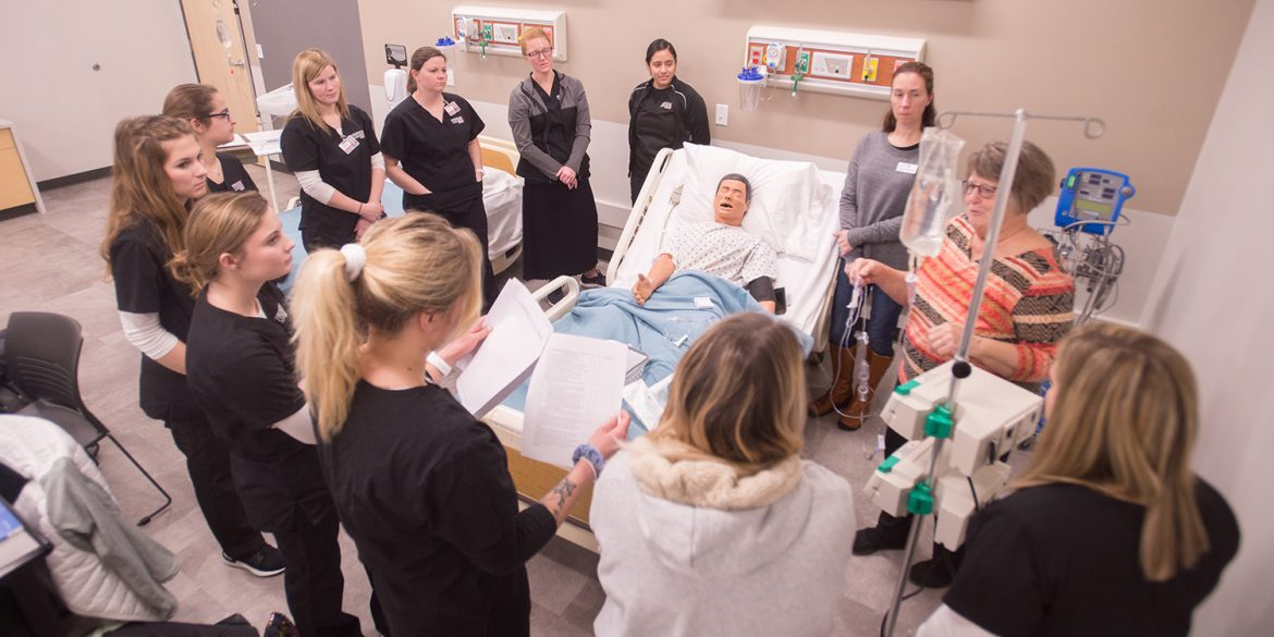 Nursing students participate in a simulation lab on the Hesston College campus.