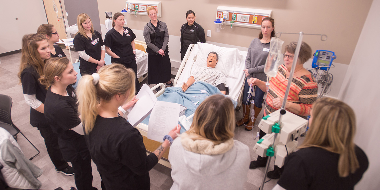 Students and faculty in the nursing skills lab