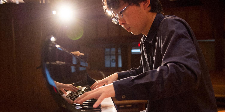 Masataka Miyake practicing piano