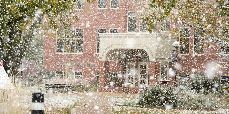 snow falls on the Hesston College campus