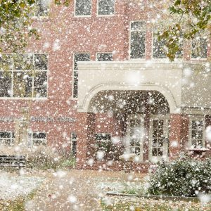 snow falls on the Hesston College campus