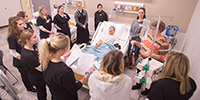 Hesston College nursing students and faculty in the skills lab