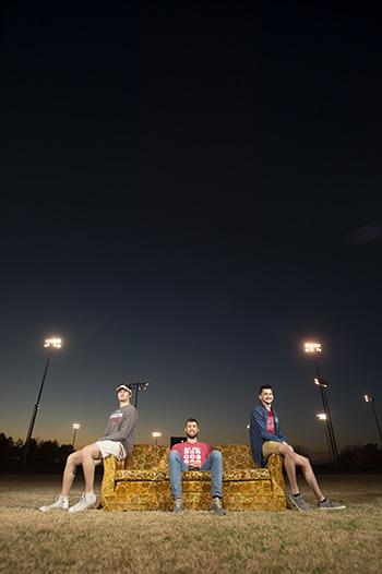 Jacob Mullins '22, Chris Lichti '21, and Ethan Klassen '21 enjoy an autumn sunset on Goldy from the center of Sieber Field.