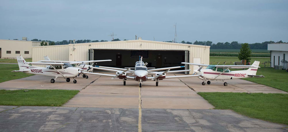 Hesston College Aviation fleet on display outside of a hangar