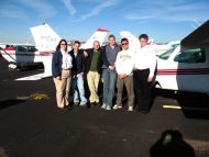 Hesston College Aviation students and instructors stading in front of a plane