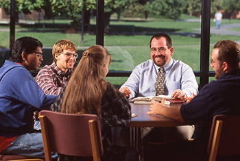 Kevin Wilder meets with students in the cafeteria during his first year at Hesston College