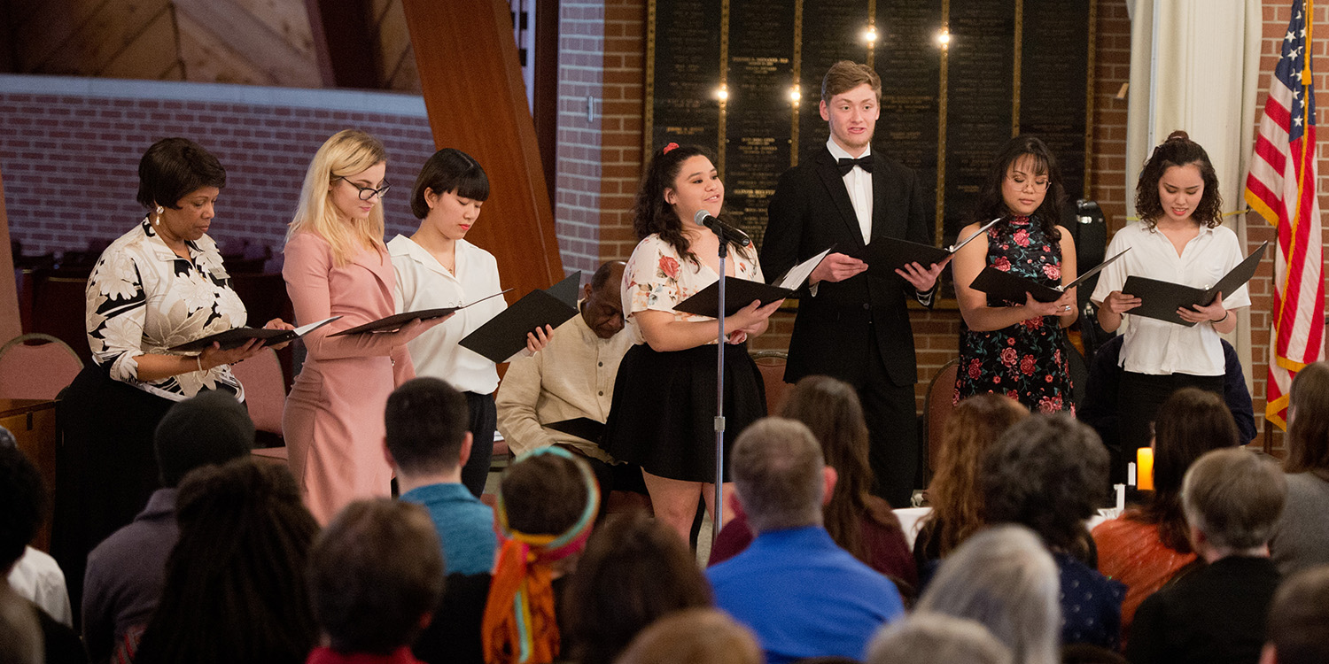 Students and Associate Academic Dean Carren Moham perform at a Peacing It Together concert, March 2020
