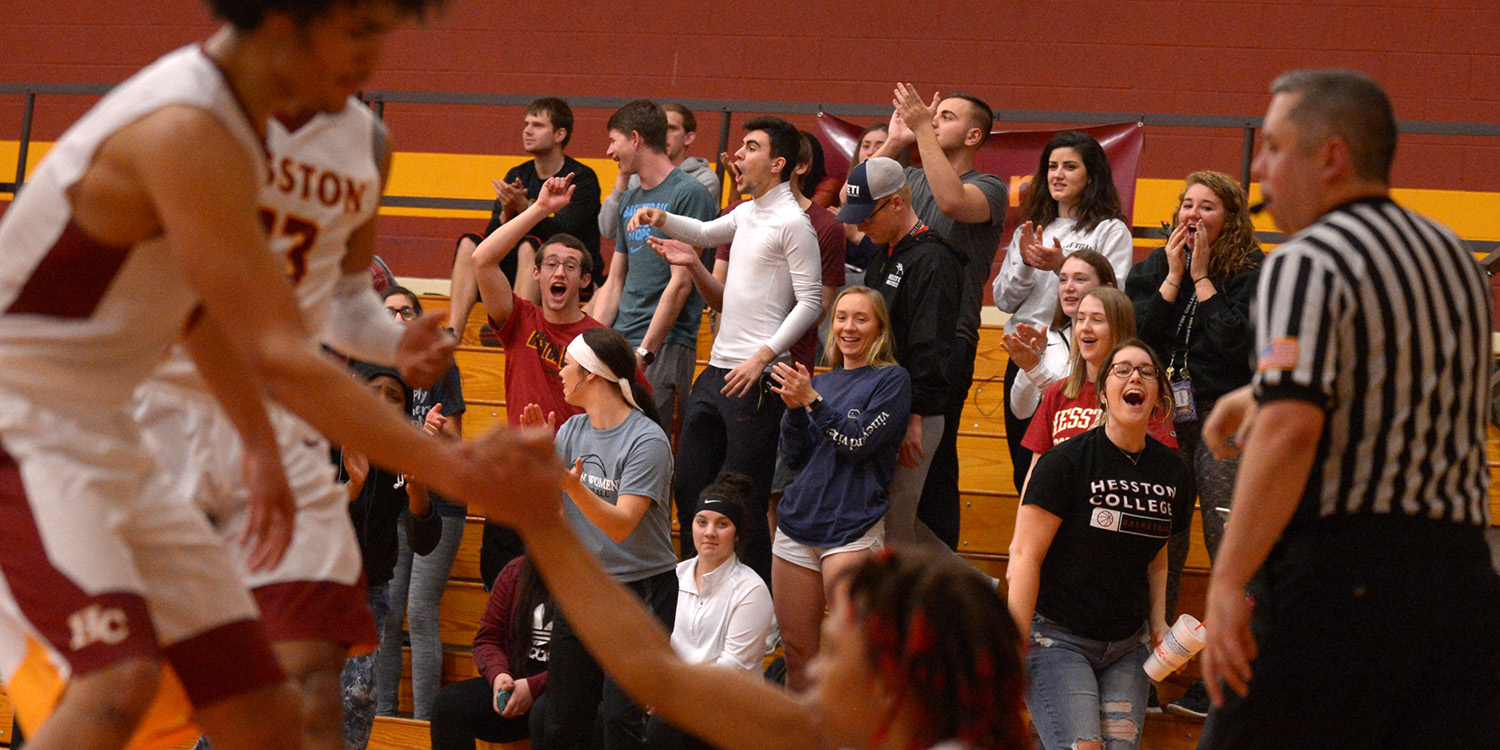The fans come alive at a Hesston College men's basketball game
