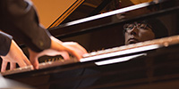 Keyboard Studies - a student performs on the college's concert Steinway