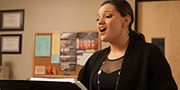 Music Scholarships - a student rehearses during a voice lesson